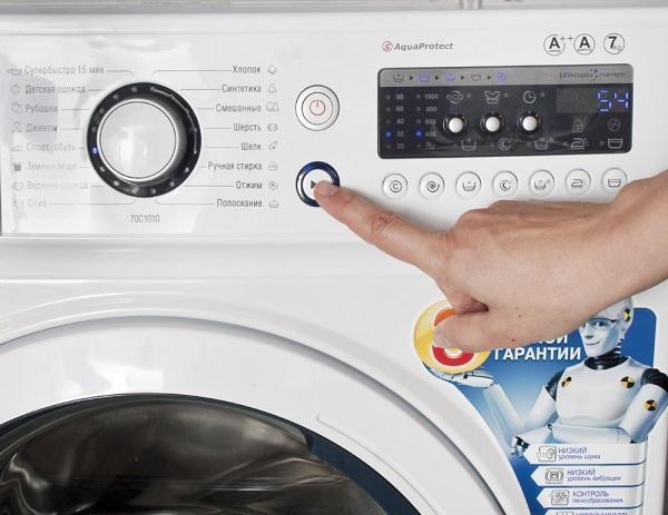 Allumer la machine à laver
