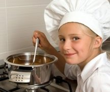 Girl cooks on the stove