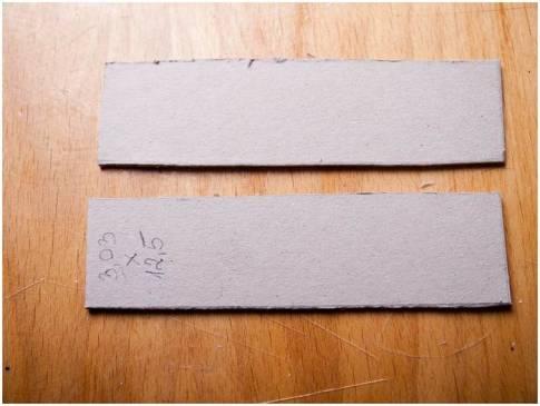 Découpe de formes en carton aggloméré pour la boîte