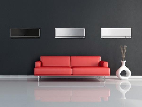 Canapé rouge et trois climatiseurs