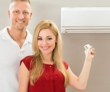 Man and woman near the air conditioner