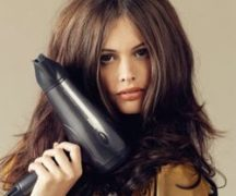 Girl with a hairdryer
